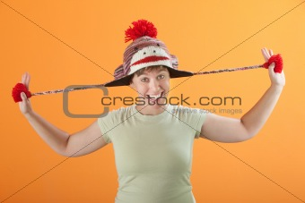 Woman Pulling Her Hat