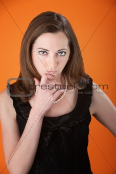 Cute Girl with Fingers on Chin