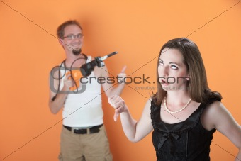 Woman Unhappy with Man's Work
