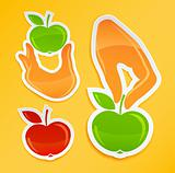 sticker with hand holding apple