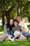 Joyful family sitting in the garden