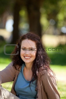 Beautiful woman sitting in the garden