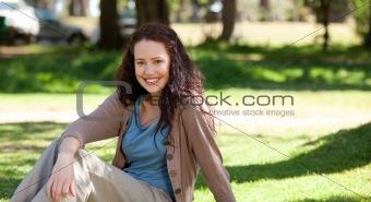 Beautiful woman sitting in the garden