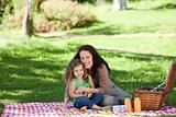 Mother and her daughter picnicking