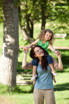 Mother giving daughter a piggyback