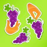 sticker with hand holding grapes