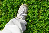 feet on a green grass