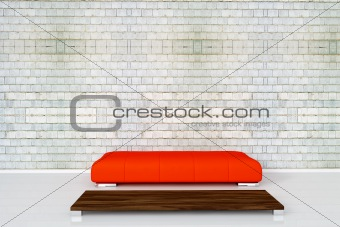 Couch on white brick wall