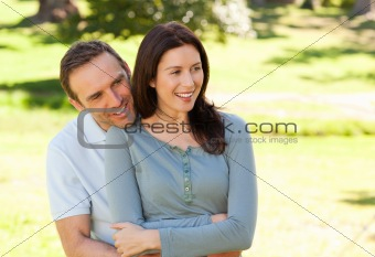 Beautiful couple hugging in the park