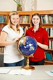 Teen Girls in Library with Globe