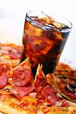 Fresh pizza and cold cola drink