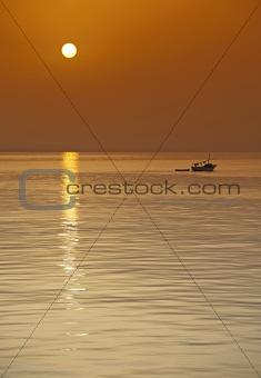Small fishing boat at sunset