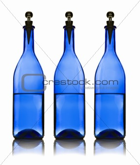 Three blue water bottles on  white background