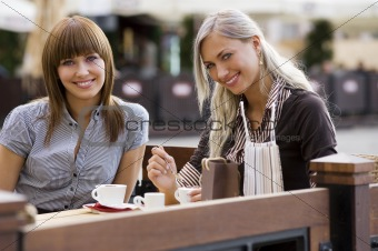 two young smiling lady in c