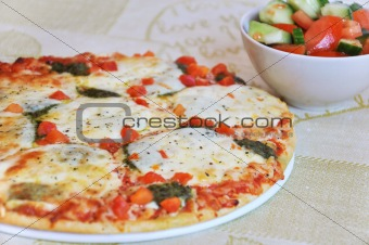 Appetizing pizza with mozzarella cheese and salad