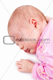 Portrait of the sleeping newborn baby girl in pink, isolated on a white background