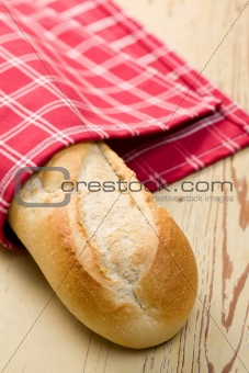french baguette on wooden table