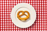 pretzel on white plate