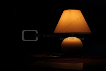 Ancient lamp on table in the dark