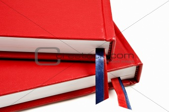 Close up of two red journals on white background