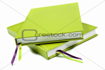 Green notebook on a pure white background