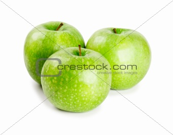 Three ripe and juicy green apples nearby with each other isolated on a white background