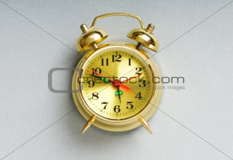 Time concept - alarm clock against the background