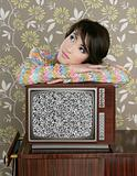 retro pensive woman on vintage wooden tv 60s