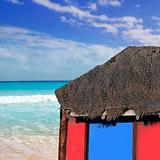 hut palapa in beach turquoise caribbean blue sky