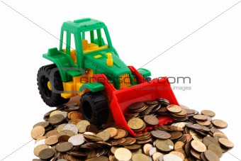Gree bulldozer raked pile of coins