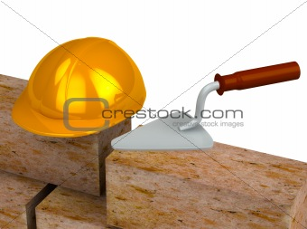 Trowel, bricks, yellow plastic helmet