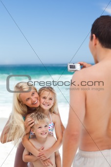 Man taking a photo of his family