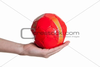 man holding red small football ball