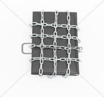 Censorship concept with book and chains