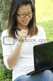 asian girl using laptop