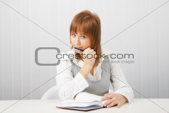 business girl with notebook and pen