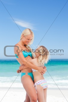 Mother embracing her daughter