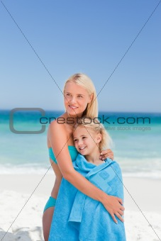 Mother with her daughter in her towel