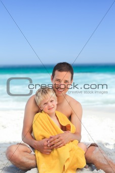 Father with his son in his towel