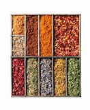 Wooden box with different herbs and spices - pepper, paprika, cu