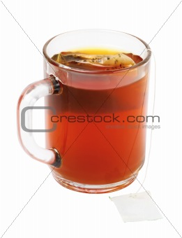 Close-up of tea bag and cup of tea isolated on white background