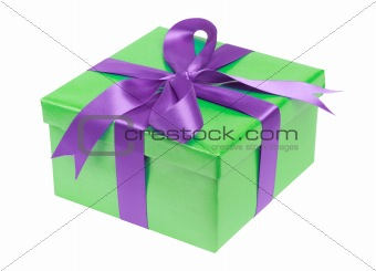 Green gift box with violet ribbon isolated on the white