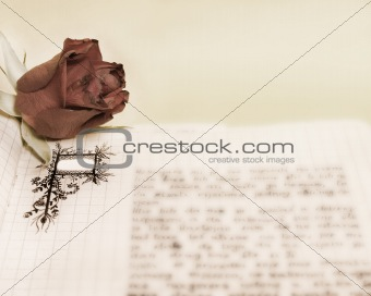 old scrapbook with a roses