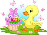 Easter duckling with a basket of eggs