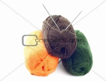 Three clews of woolen yarn