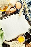 Open notebook and fresh ingredients