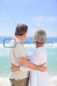 Elderly man embracing her wife