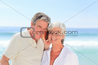 Retired couple listening to their shell