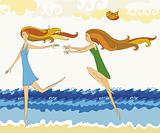 Two girls running on a beach
