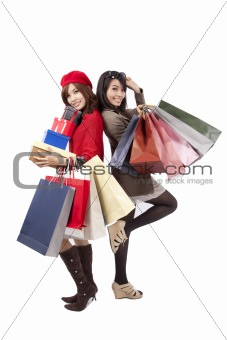Two happy shopping  beautiful girls with the bags